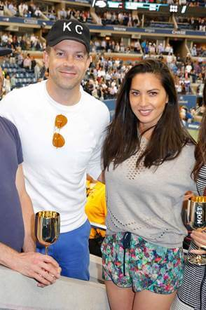 Jason Sudekis and Olivia Munn toast to the US Open Finals from the Moët & Chandon suite.