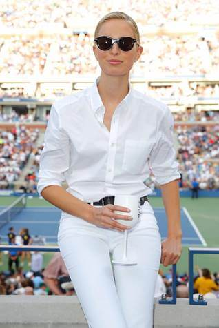 Karolina Kurkova decked from head to toe in white, with her Moet Ice chalice