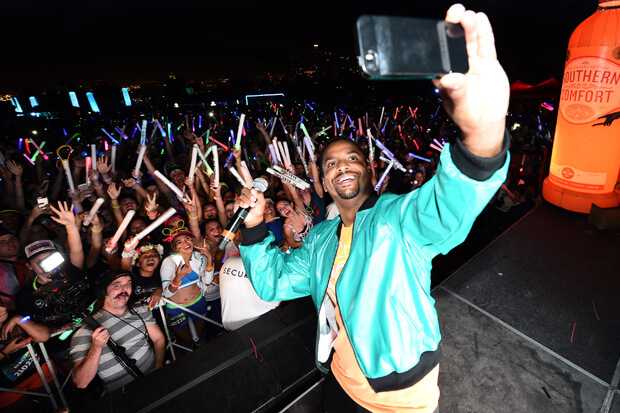 """Dancing with the Stars' fan-favorite Alfonso Ribeiro takes a group selfie at Southern Comfort's World's Largest Group Toast at this year's Electric Run, Los Angeles."""