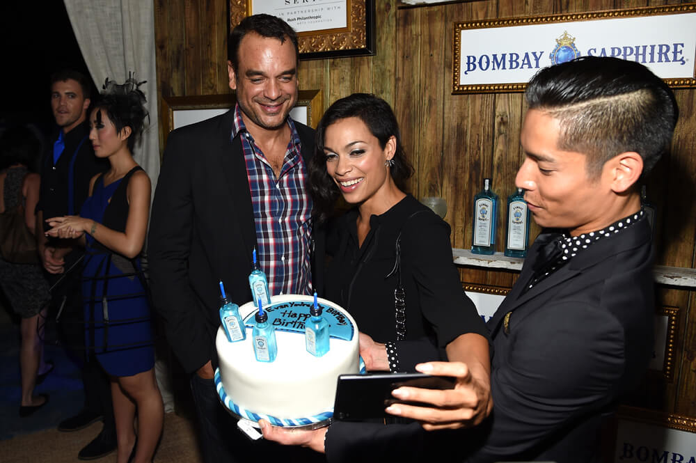 "Rosario Dawson toasts to the birthday of her manager, Evan Hainey, which was one day prior (Dec 3) with a Sapphire blue cake decorated with mini bottles of Bombay Sapphire:  ""Evan – You're the BOMBay, Happy Birthday!"""