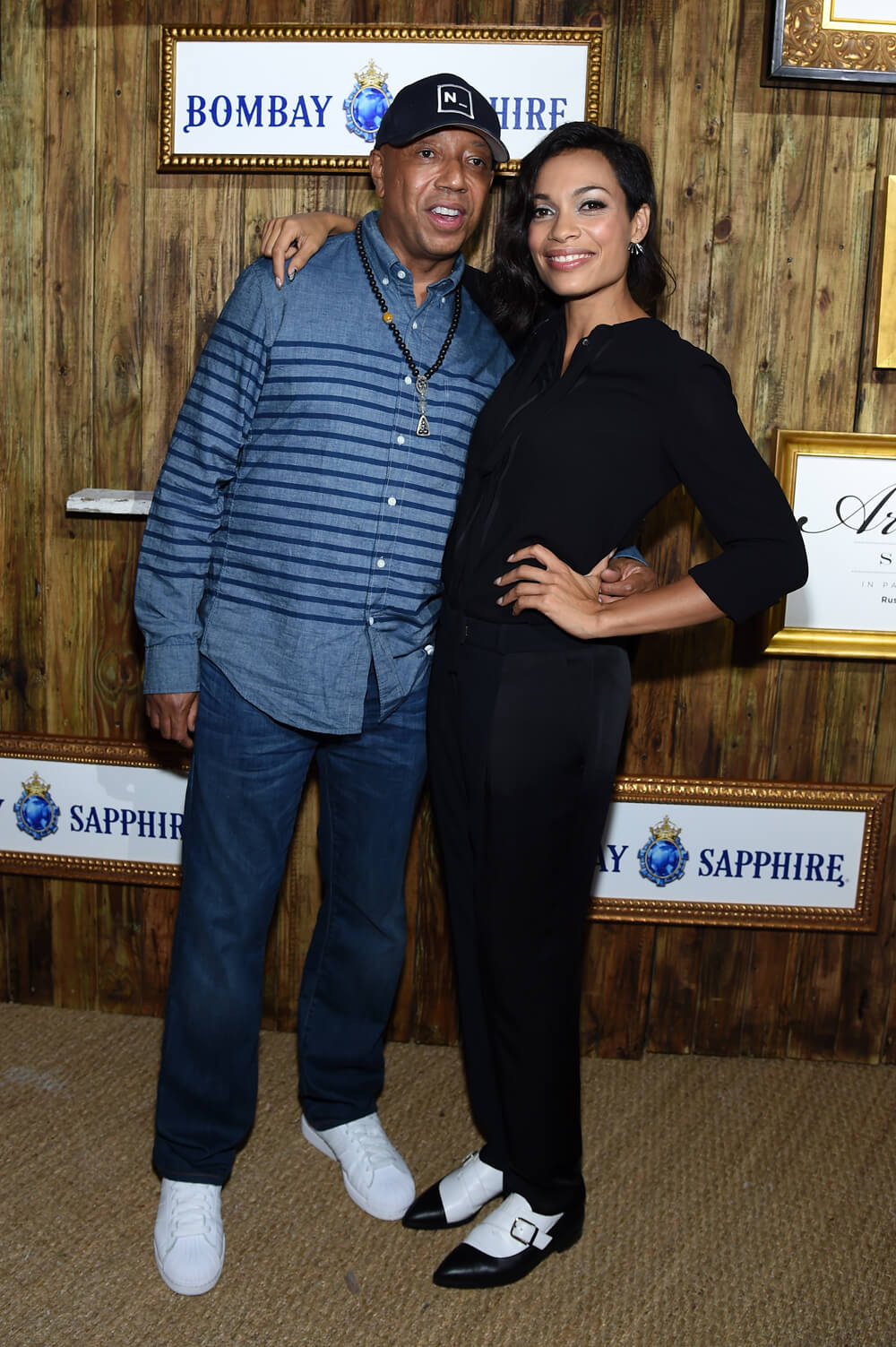 Russell Simmons and Rosario Dawson celebrate the 5th Annual BOMBAY SAPPHIRE Artisan Series Finale at Soho Beach House during SCOPE Miami Beach